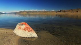 Unny day on the shore of a mountain lake. Mongolia.  stock footage