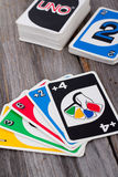 Uno card game on wood table Stock Photos