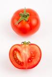 Uno e pomodoro mezzo Fotografia Stock