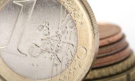 Uno euro e monete Immagini Stock