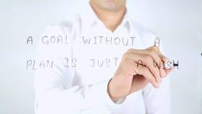 Uno scopo senza un piano è appena un desiderio, scrittura dell'uomo sul vetro, scritto a mano Immagini Stock Libere da Diritti