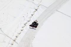 Uno spazzaneve al Jungfraujoch in Svizzera Immagine Stock