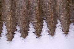 Uno strato dell'ardesia nella neve Immagine Stock Libera da Diritti