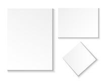 Uno strato della carta in bianco Svuoti nelle posizioni differenti ed ha girato Immagini Stock