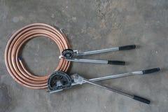 Uno strumento della piegatrice del tubo per il tubo di rame Immagine Stock Libera da Diritti