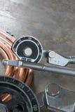 Uno strumento della piegatrice del tubo per il tubo di rame Fotografie Stock
