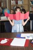 Uno studio dei tre allievi della scuola elementare Immagine Stock