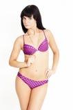 Uno swimwear da portare del brunette della ragazza piacevole di modo Fotografie Stock