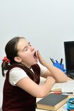 Unobservant pupil teen girl yawns. Hard to do homework, I want to sleep royalty free stock photos