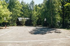 Unoccupied basketball playground in the city park.  royalty free stock photos