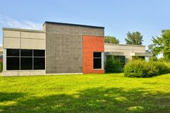 Unoccupied generic backside of store, business or professional office space. Sunny summer day stock photography