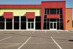 Unoccupied generic store front, business or professional office space. Sunny summer day royalty free stock photography