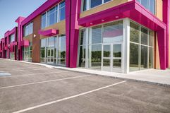 Unoccupied generic store front, business or professional office space. Sunny summer day stock images