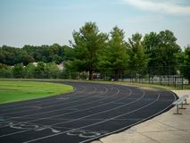 Unoccupied neighborhood track at evening hours, ready for offseason training royalty free stock photos