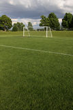 Unoccupied Soccer Field. A view of a net on a vacant soccer pitch Royalty Free Stock Photography