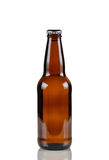 Unopened beer bottle on white with reflection Royalty Free Stock Photo