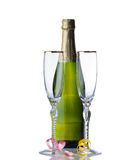 Unopened bottle of sparkling wine with tall glasses ready for th Stock Photos