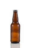 Unopened cold beer bottle on white with reflection Stock Photos