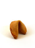 Unopened fortune cookie. Isolated on white background stock image
