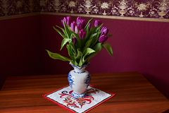 Lilac Tulips. Bud, petals, bouquet. close-up. Unopened lilac tulip bud close-up a decorative vase stand on a table. Russia, Moscow, holiday, gift, mood, nature Stock Image