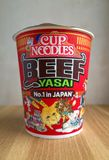 Unopened pot of Beef and Yasai flavor Cup Noodles. Bracknell, England - March 13, 2018: Unopened carton of Instant Beef and Yasai Cup Noodles produced by the stock images