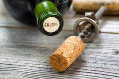 Unopened Red Wine Bottle with opener in background Royalty Free Stock Photo
