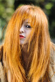 Unordentliches blondes behaartes junges vorbildliches Porträt im Sonnenlicht Lizenzfreie Stockbilder