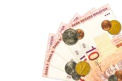 Unos 10 billetes de banco y monedas del ringgit malasio foto de archivo