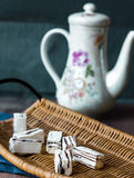 Unpacked candy in a wooden basket, tea Stock Photo