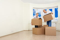 Unpacking. A man and a woman are unpacking royalty free stock image