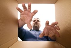 Unpacking The Box. Person unpacking (or packing) a cardboard carton Royalty Free Stock Photo