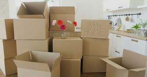 Unpacking Boxes In New Home On Moving Day. Moving to a new home concept. unpacking boxes, footage of big cardboard boxes. New home owners unpacking boxes stock video