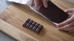Unpacking chocolate bar stock video