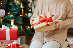 Unpacking gift. Woman opening gift-box with xmas present Stock Photo