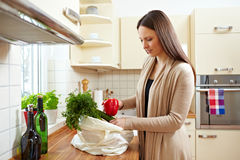 Unpacking groceries in kitchen Royalty Free Stock Image