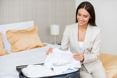 Unpacking her suitcase. Royalty Free Stock Images
