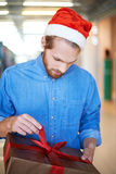 Unpacking present Royalty Free Stock Images