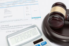 Unpaid bill with calculator and wooden gavel over it series royalty free stock photos