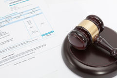 Unpaid bill with wooden gavel over it series Royalty Free Stock Image