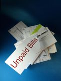 Unpaid bills. On blue background Stock Images