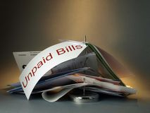 Unpaid bills. Accounts payable on a colored background Stock Photography