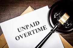 Unpaid Overtime title On Legal Documents. royalty free stock photography