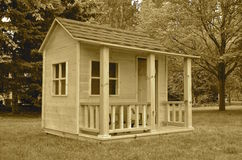 Unpainted backyard playhouse(sepia) Royalty Free Stock Images