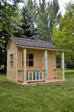 Unpainted backyard playhouse Royalty Free Stock Photos