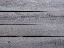 Unpainted edging boards. A grey wooden wall of a shed Stock Image