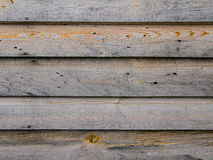 Unpainted edging boards. A grey wooden wall of a shed Stock Photo