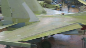 Unpainted fighter plane is in shop for production of aeronautical equipment. Aviation industry is a major branch of engineering. In field of aircraft stock video