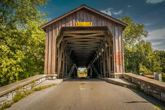 Unpainted Hunsecker Mill Bridge in Lancaster County. Lancaster, PA - June 9, 2012: Hunsecker`s Mill Covered Bridge is unpainted and crosses the Conestoga River Royalty Free Stock Photos