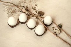 Unpainted plywood with white eggs in brown corrugated paper Royalty Free Stock Image