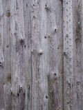 Unpainted unedging boards. A grey wooden wall of a shed Royalty Free Stock Photos